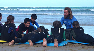 Surf coaching at Middle School camp