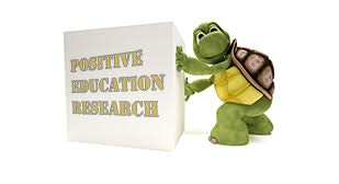 Tortoise pushing a box saying Positive Education Research